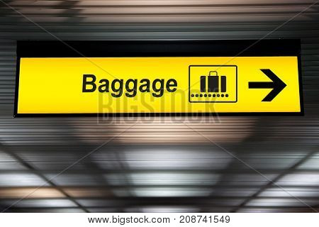 baggage airport signs hanging from ceiling from airport terminal