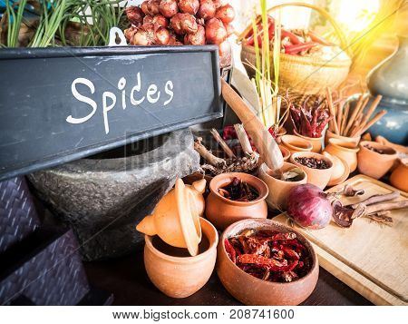 Spices and herbs in small jar. Food and cuisine ingredients. Colorful natural additives.