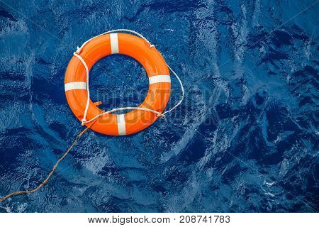 Safety equipment Life buoy or rescue buoy floating on sea to rescue people from drowning man.