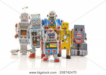 SWINDON UK - OCTOBER 12 2017: Row of old clockwork tin robots in a line on a white background