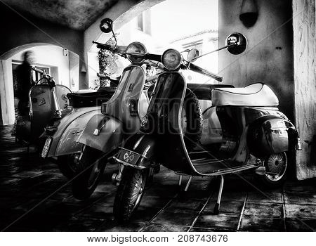 Porto Cervo, Italy - June 29, 2016: Piaggio Vespa and lambrettavintage sprint motor scooter motorbike motorcycle