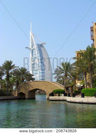 Jumeirah Dubai United Arab Emirates, 13 August 2013: river and bridge view with luxury hotel Burj Al Arab in background Dubai UAE