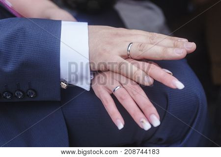 Newlyweds Hands With Wedding Rings