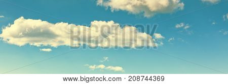 Long wide banner with blue sky and clouds background