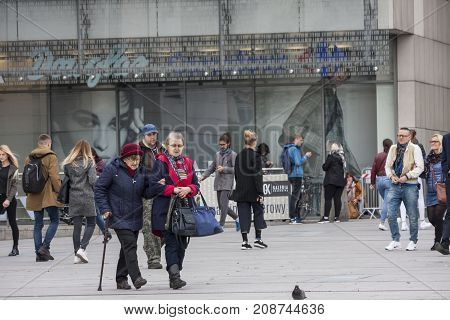 Square in front of the shopping centre Cracow Poland - October 13 2017: People are walking around entry of Galeria Krakowska shopping centre Cracow Poland.