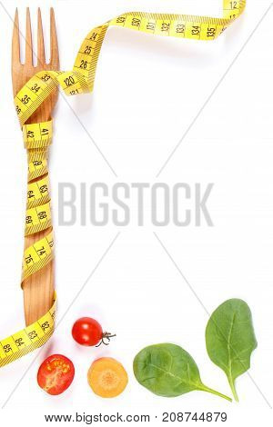 Frame Of Wooden Fork Wrapped In Tape Measure And Fresh Ripe Vegetables, Concept Of Slimming