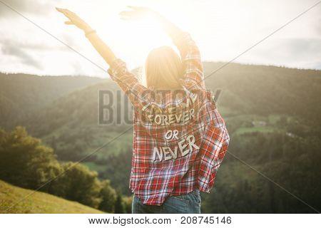 Woman hands up the Carpathians mountain tour. Woman enjoying sunset