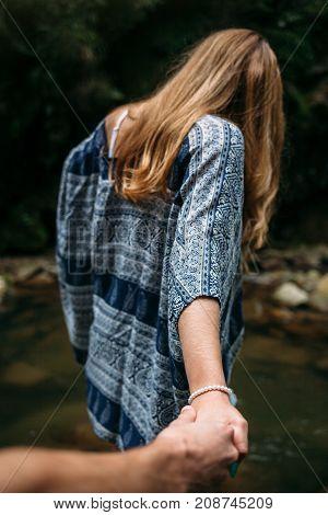 Follow Me. Brave Traveling Woman Walking Ahead Near Carpathian River