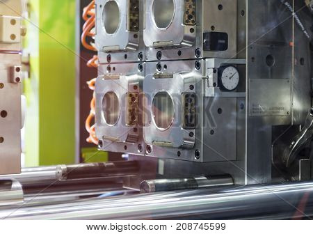 Plastic inJection machine ; at mold component