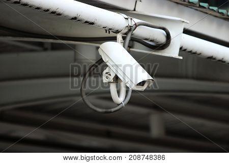 Security CCTV camera or surveillance in city.