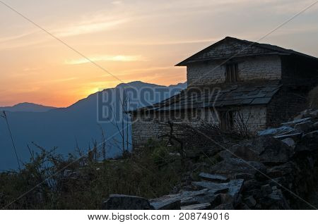 Silhouette Of Nepalese Traditional Brick House During Sunset In Kaski District, Annapurna Himal.