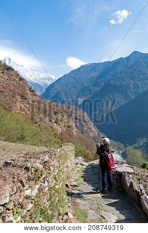 Unidentified Person Looking At The View Of Annapurna Mountain Range At The Trekking Trails Of Annapu