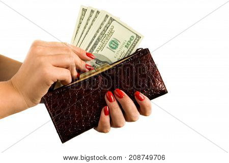 Female hands with a beautiful manicure hold a purse and money. On a white background.