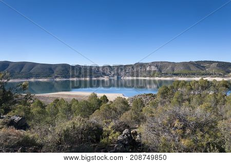 Views of Buendia Reservoir in the upper waters of the river Tagus Cuenca Castilla La Mancha Spain. The surface area of the reservoir measures 8194 hectares and it can hold a total of 1638 cubic hectometres
