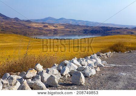 Stones on the roadside in Turkey. Landscape.