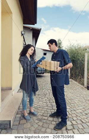 Courier Woman Receiving Boxes Home Delivery Man