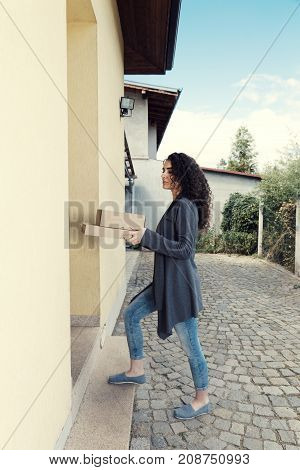 Curly Woman Holding Boxes Home Shopping Pave