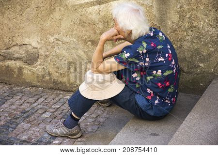 Czechia Old Women Sitting Lonely At Pathway Of Prague Castle