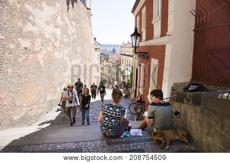 Czechia Two Women Sit And Drawing Watercolor Painting Prague City With Dog Sleep On Pathway Of Pragu