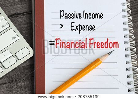 formula showing financial freedom on a notebook