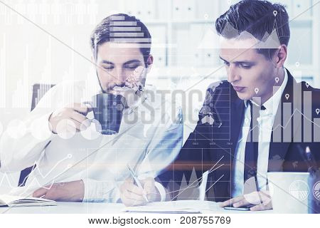 Two Business Partners In Office, Graphs