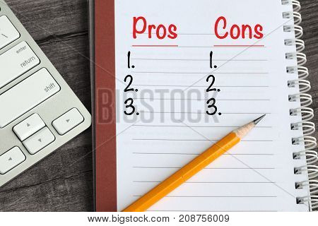 Pros and Cons concept on a notebook