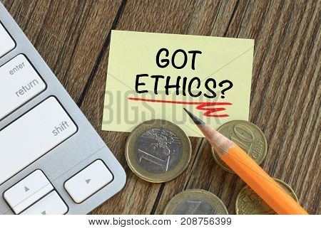 concept of got ethics on a note, with desk background