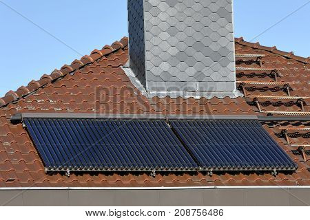 A Solar collectors on a house roof