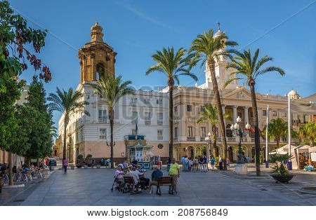 CADIZ,SPAIN - SEPTEMBER 30,2017 - At the place San Juan de Dios with church and city hall in Cadiz. Cadiz is the oldest continuously inhabited city in Spain.