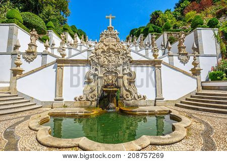 The first symbolic fountain at the beginning of ornamental stairway that zig zags up the hill towards the church of Bom Jesus do Monte, a popular pilgrimage site in northern Portugal, Tenoes in Braga.