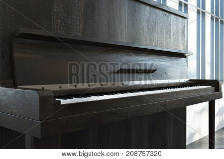 Close up of a dark wooden piano with an open cover standing in a loft room with a concrete floor. Concept of creativity. 3d rendering mock up
