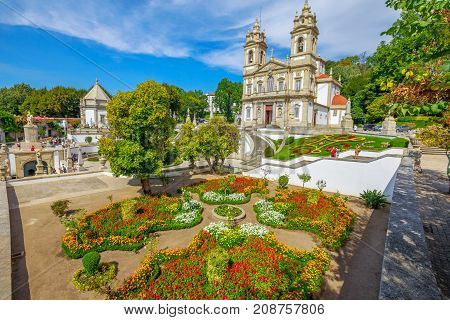 Aerial view of neoclassical Bom Jesus do Monte Sanctuary and magnificent flowered gardens in a sunny day. Tenoes near Braga. The Basilica is a popular landmark and pilgrimage site in northern Portugal