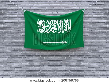 Saudi Arabia flag on brick wall. 3D illustration