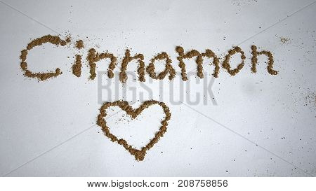 Cinammon spelled with letters in the spice and a heart underneath