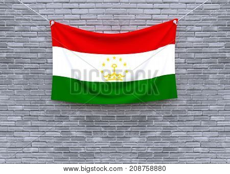 Tajikistan flag on brick wall. 3D illustration
