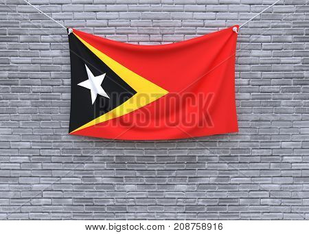 East Timor flag on brick wall. 3D illustration