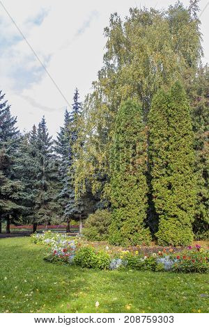 Early autumn panorama of a public park without people