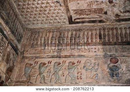 MORTUARY TEMPLE OF SETI I, ABYDOS, EGYPT - NOVEMBER 12, 2016: Hieroglyphic carvings and paintings on the interior walls of the temple