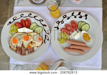 Plates With Rich Breakfast