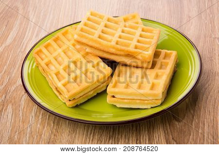 Heap Of Waffles In Green Plate On Table