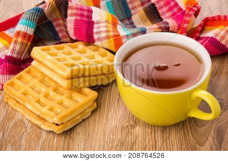 Two Waffles, Cup Of Tea And Checkered Napkin On Table