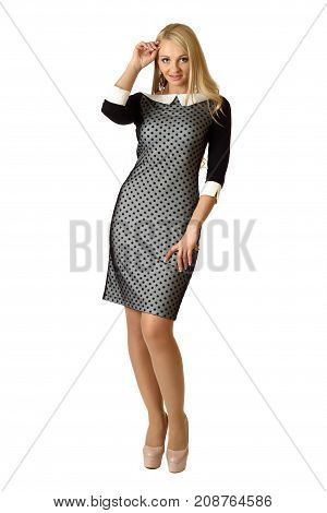 Young beautiful woman in cocktail dress isolated on white background.