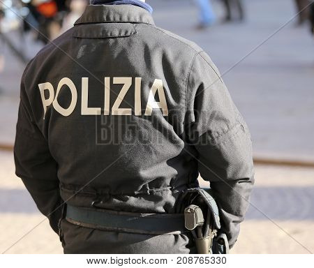 Italian Policeman During An Anti-terrorist Patrol On The Streets