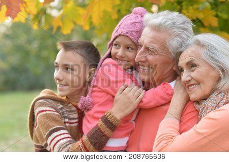 Family portrait of happy grandparents and grandchildren