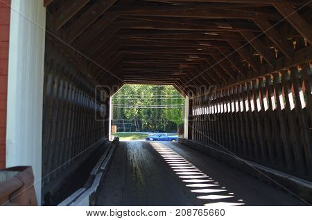 A red wooden covered bridge in Vermont