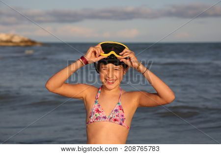 Smiling Little Girl With Diving Mask Plays And Dives
