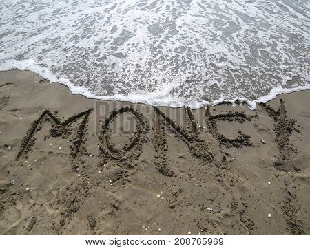 Word Money On The Sand And Wave That Is Erasing The Text Symbol