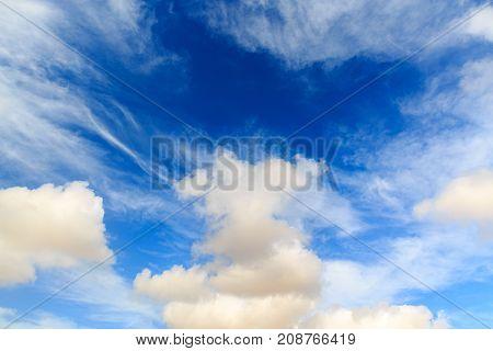 Big fluffy clouds at dark blue sky