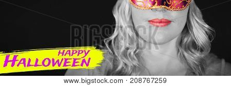 Digital image of happy Halloween text against portrait of woman in masquerade mask