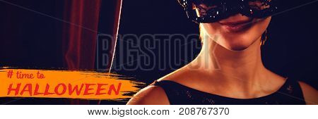 Graphic image of time to Halloween text against portrait of woman in masquerade mask